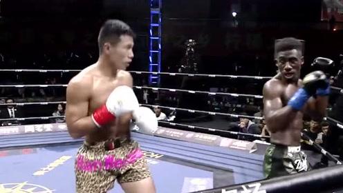 外国巨人拳王想高扫腿KO中国硬汉,反被中国拳手击头取胜