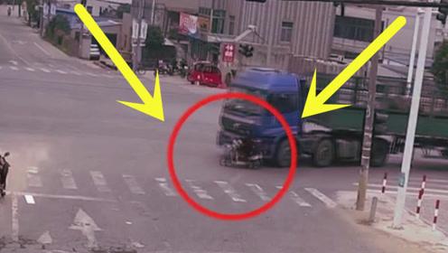 大妈被卷入货车车底,5秒后竟奇迹逃生,监控拍下惊魂一幕!