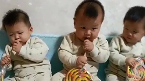 三胞胎一起吃糖,其中两个萌宝亮了,网友:没见过这样吃糖的
