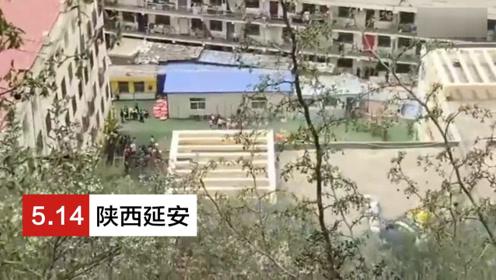 消防员用铁锨山坡上灭火 坡下幼儿园小朋友们呐喊助威