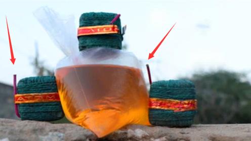 趣味实验:牛人用鞭炮点燃一整袋汽车油会发生什么,结果天降火雨