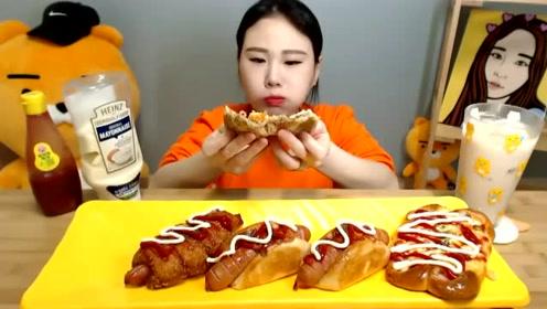 韩国大胃王吃的是香肠面包,中间夹着香肠,搭配上两种酱松软好吃