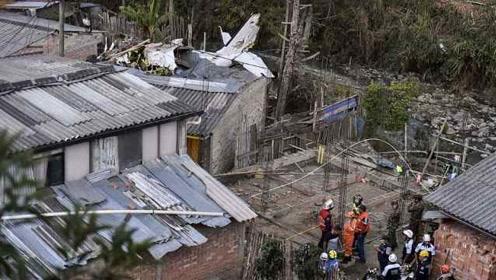 哥伦比亚一客机坠毁居民区,已致七人死亡