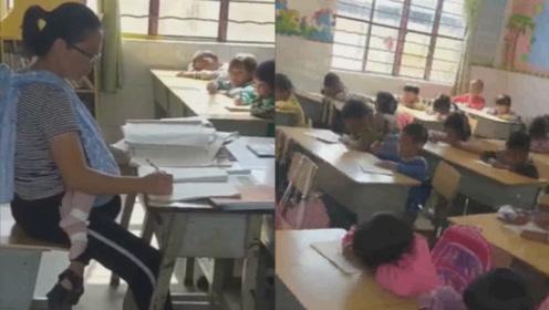 乡村女教师背4个月发烧女儿批改作业:是伟大母亲更是负责教师