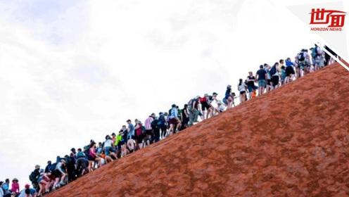 政府为保护史前巨石颁布禁爬令 结果反引来游客蜂拥登顶