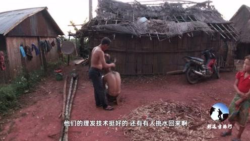 实拍老挝山村人住的茅草房,太简陋了,下雨就漏水