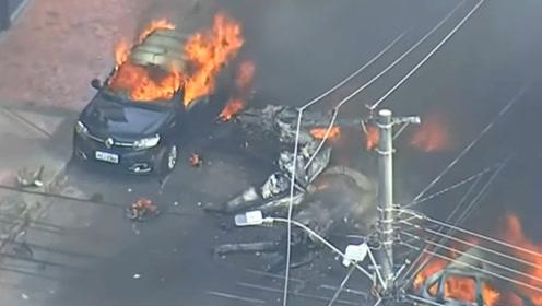 巴西一飞机坠毁冲进住宅区 多辆小车爆炸街道被大火覆盖 3人死亡