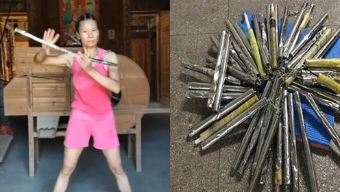 女硕士痴迷李小龙苦练双截棍 7年打坏60根钢棒出手惊人