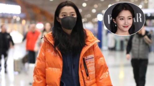真佩服关晓彤,顶着素颜穿着大棉袄就走机场,意外的清新活力
