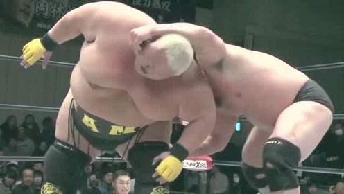 日本壮汉想抱摔500斤大胖子,竟用些下三滥的招数,不料却误伤自己!