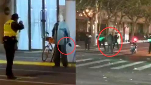 上海一5旬男子街头持刀欲行凶 实拍:民警到场后开枪将其制服
