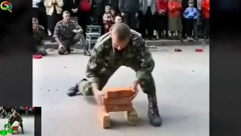 这当兵的小伙尴尬了,这么多人看着愣是不能把砖劈烂,质量太好了