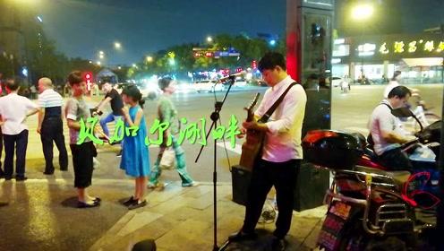 杭州街头流浪歌手深情演唱《贝加尔湖畔》路人流连忘返
