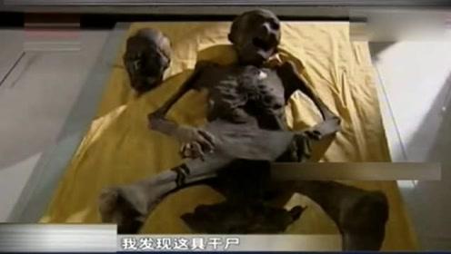 农民种田挖出古墓,棺内墓主面目狰狞胎盘外露,疑似墓中复活