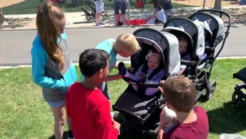五胞胎宝宝去户外透气,吸引了一群熊孩子,太可爱了