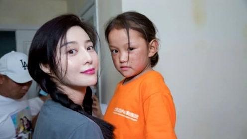 范冰冰医院探望心脏病儿童,扎麻花辫似少女,还被小女孩现场表白
