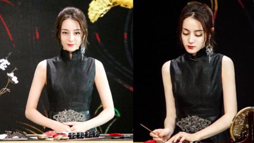 迪丽热巴身穿黑色旗袍端庄典雅 单边蝴蝶耳饰精致时尚