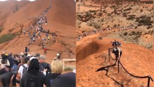 澳洲著名岩石奇观即将封禁 上千名游客排长队抢先攀登