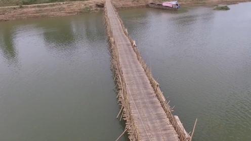"""世界最长一座""""手工桥"""":用5万根竹子建成,不过每年都要拆掉重建一次!"""