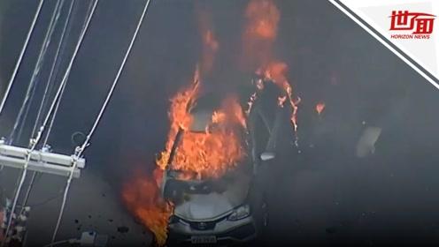 现场:巴西一飞机坠毁撞上汽车 住宅区街道升起浓烟