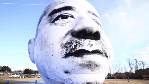 日本这是啥街头艺术?空中24小时飘长脸,看着就吓人!