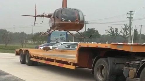 朋友都有钱买直升机了,居然加不起油,出门还得让货车拉!