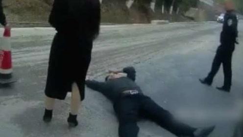 妻子逆行被查,丈夫护妻躺地撒泼称交警非礼被拘7日