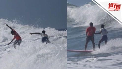 遥遥领先的冲浪选手突然掉头 竟是为救坠海遇险的竞争对手