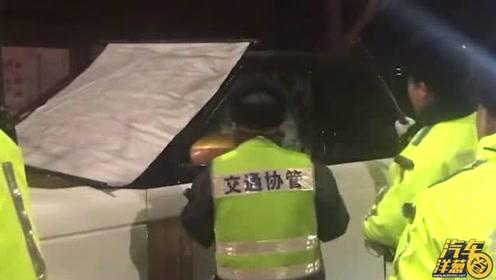 女司机酒驾被破窗,交警防事故遮上布