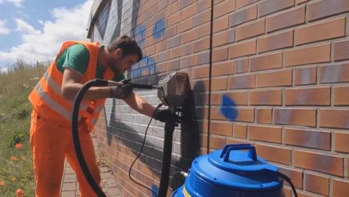 老外发明新型墙面广告清洁机,能轻松清除涂鸦,还环保不伤墙体