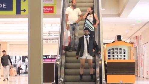 街头恶搞:穿西装的小伙配条短裤就出门,路人笑惨了