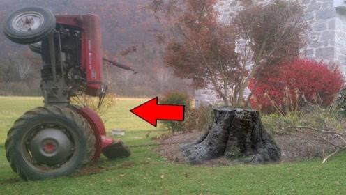 国外大叔用拖拉机拔树根,看着这滚滚黑烟,就知道这个方法不可取