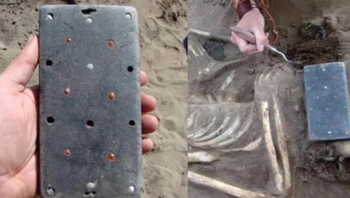 中国考古学家在2100年前的古墓中,竟发掘iPhone手机?