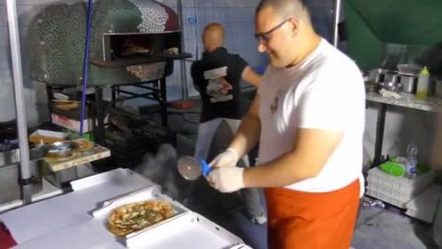 意大利街头的披萨美食,店员现场烹饪烤制,还没出锅就闻到香味了