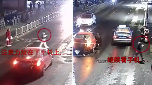 与死神擦肩而过!男子过马路看手机被撞 起身后继续看手机