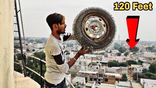 小伙把钢钉轮胎从120米高空扔下,你猜会发生什么?
