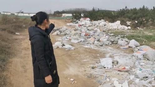 地里被倾倒建筑垃圾数月 村干部竟说不知情