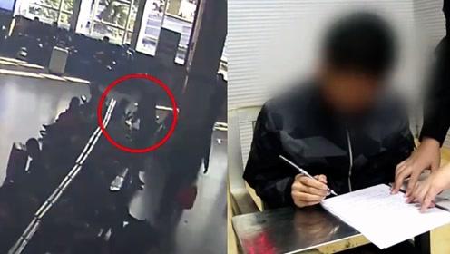 监控曝光!广西男子在火车站内乞讨 被拒后发怒划坏旅客手机