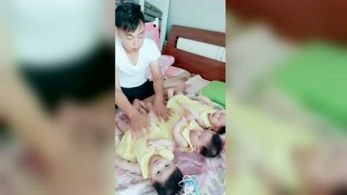 萌娃三胞胎:生了三千金,就是这么给宝爸拿来摆弄的。