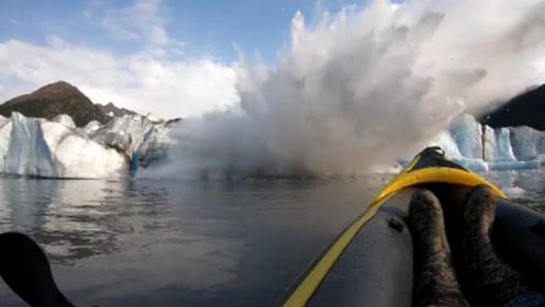 死里逃生!男子划船近距离观察冰山 冰山突然崩塌掀起巨浪险丧命