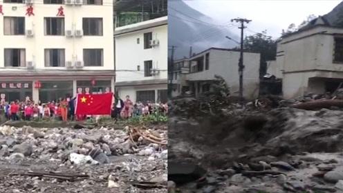 汶川居民举国旗致敬支援特警 泥石流已致10人遇难28人失联
