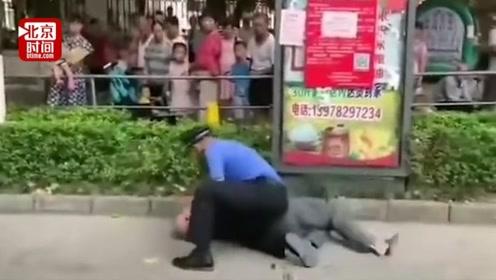 城管当街殴打老人?官方否认:商贩酒后辱骂阻挠执法 被城管制伏