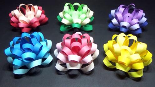 手工折纸艺术,使用纸带制作礼物盒扎花装饰花