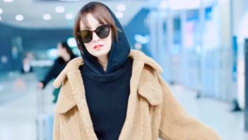 吴昕穿羊羔毛大衣现身机场,造型清新可爱,时尚感真是A爆了!