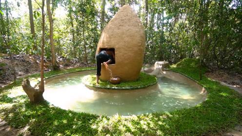 男子归隐荒野,就地取材打造双层别墅泳池,钻进去见识一下!
