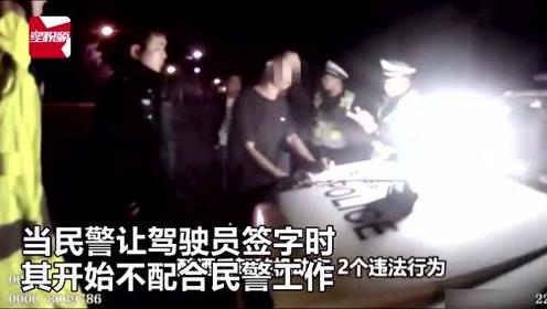 """广西一男子酒驾被查,现场对民警发出""""斩杀""""威胁:你走我就砍你"""