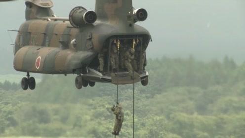 日本自卫队富士山下实弹演习 战车奔驰火炮轰鸣观众手机拍照不停